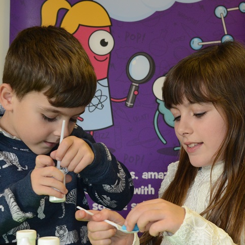 2 children playing with science with letterbox lab science subscription box