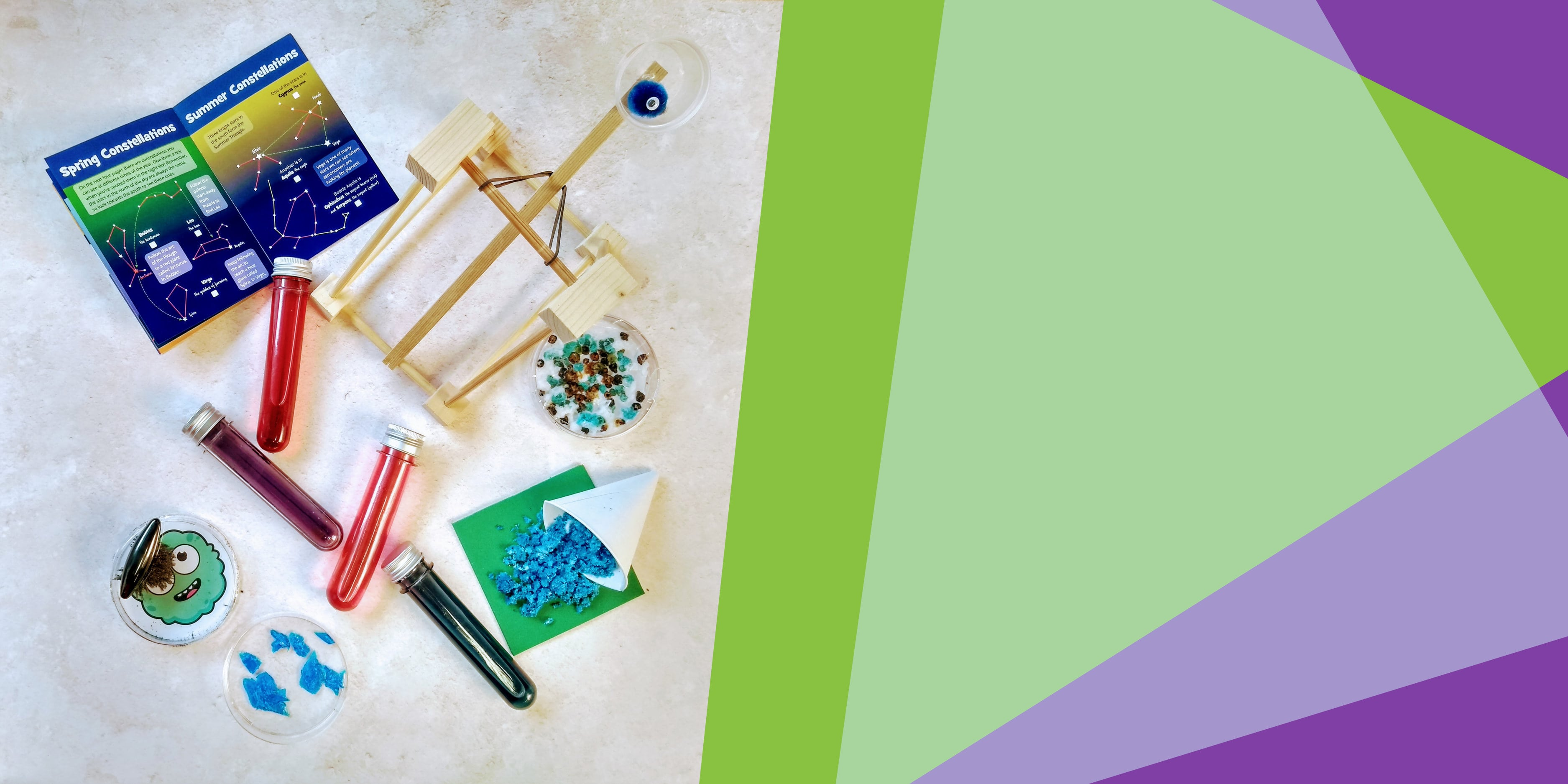 a catapult, colourful test tubes, crystals and other science experiments